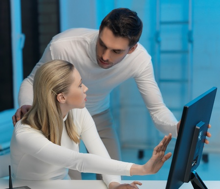 futuristic man: picture of man and woman in space laboratory Stock Photo