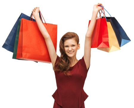 picture of teenage girl in red dress with shopping bags Stock Photo - 17450294