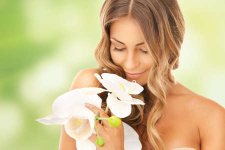 picture of beautiful woman with orchid flower Stock Photo - 17480077