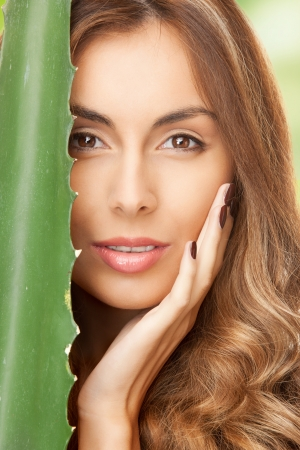 picture of lovely woman with aloe vera Stock Photo - 17480126