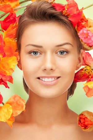 picture of lovely woman with red flowers Stock Photo - 17480110