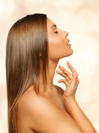 face and hands of beautiful woman with long hair Stock Photo - 17480089