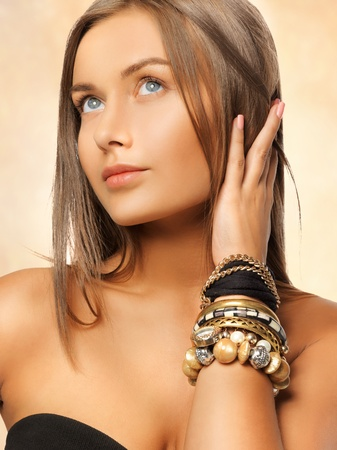 tanned: bright picture of beautiful woman with bracelets