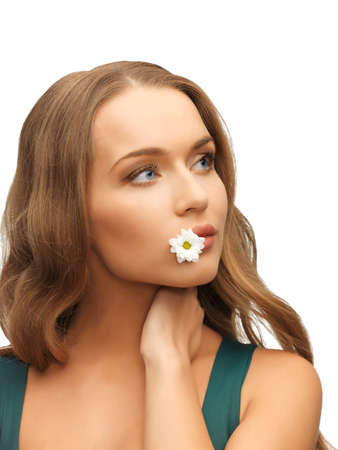 picture of beautiful woman with camomile in mouth Stock Photo - 17480118