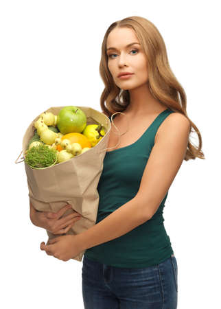 picture of woman with shopping bag full of fruits Stock Photo - 17480050