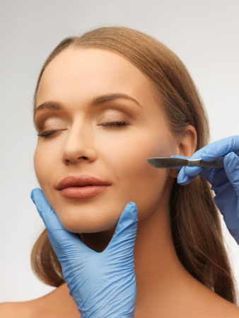 picture of woman face and beautician hands with scalpel Stock Photo - 17480116