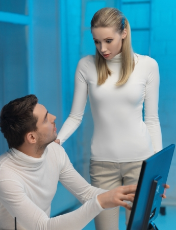 picture of man and woman in space laboratory Stock Photo - 17480085