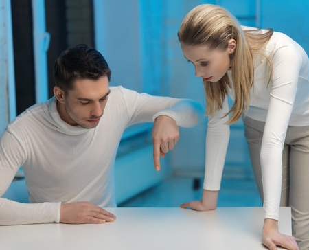picture of man and woman working with something imaginary Stock Photo - 17480084