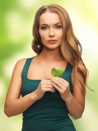 bright picture of woman with spinach leaves Stock Photo - 17480058