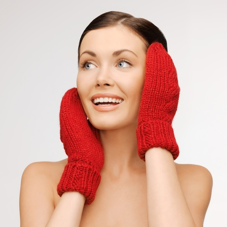bright picture of beautiful woman in red mittens.. Stock Photo - 17480046