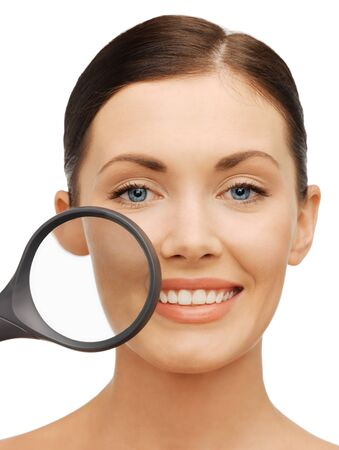 soft skin: bright picture of beautiful woman with magnifying glass