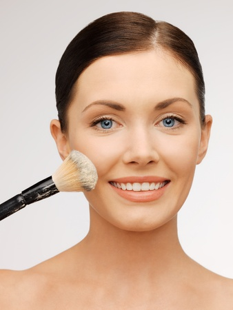 bright closeup portrait picture of beautiful woman with brush. Stock Photo - 17480053
