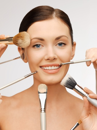 bright closeup portrait picture of beautiful woman with brushes. Stock Photo - 17480068