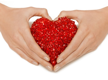 bright closeup picture of woman hands holding heart Stock Photo - 17480056