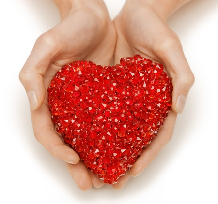bright closeup picture of woman hands holding heart photo
