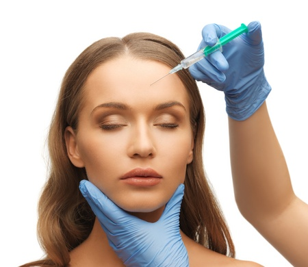 picture of woman face and beautician hands with syringe Stock Photo - 17480016