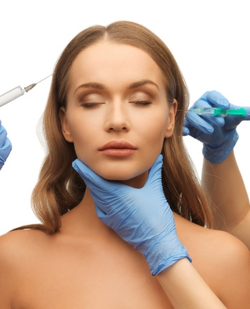 picture of woman face and beautician hands with syringes Stock Photo - 17480117