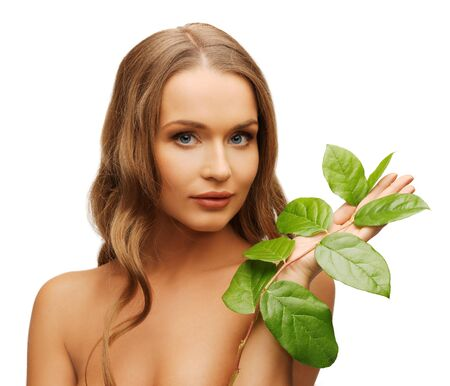 picture of woman with green leaf over white. photo