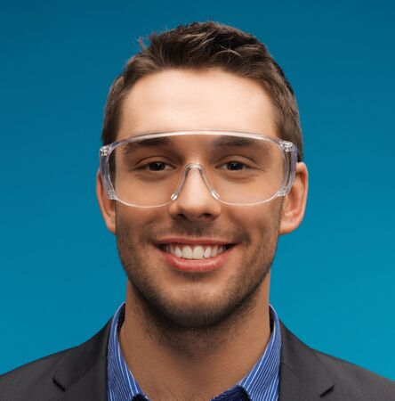 picture of handsome businessman in protective glasses. photo