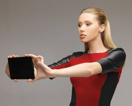 bright picture of futuristic woman with tablet pc Stock Photo - 17480098