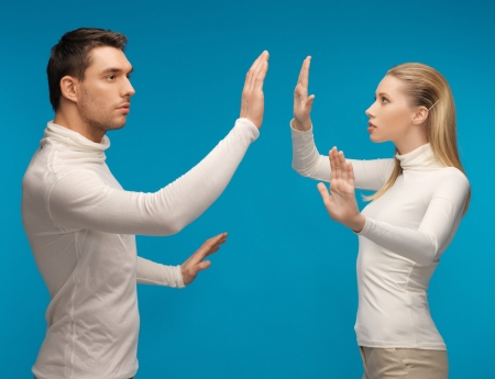 picture of man and woman working with something imaginary. Stock Photo - 17480091