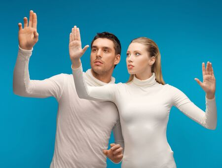 picture of man and woman working with something imaginary. Stock Photo - 17480096