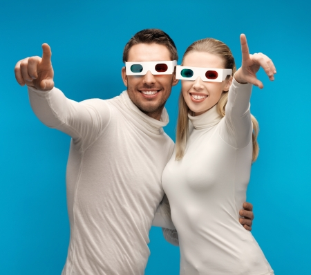 man and woman with 3d glasses pointing their fingers Stock Photo - 17480052