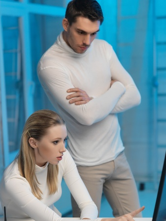 picture of man and woman in space laboratory Stock Photo - 17480119