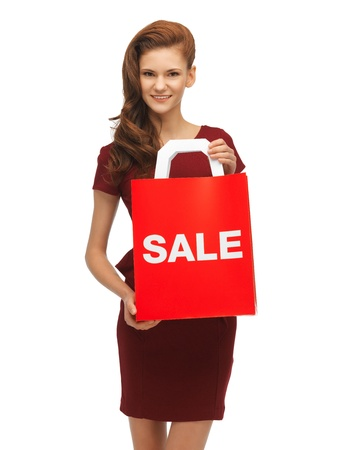 picture of teenage girl in red dress with sale sign photo