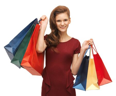 picture of teenage girl in red dress with shopping bags Stock Photo - 17480071