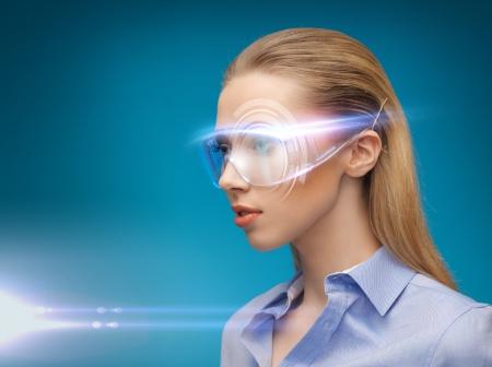 bright picture of businesswoman with digital glasses photo