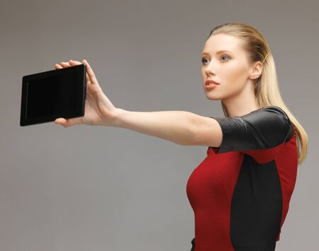 bright picture of futuristic woman with tablet pc Stock Photo - 17540292