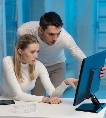 picture of man and woman in space laboratory Stock Photo - 17540242
