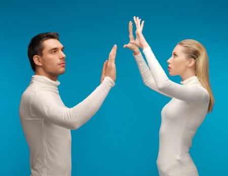 picture of man and woman working with something imaginary Stock Photo - 17540239