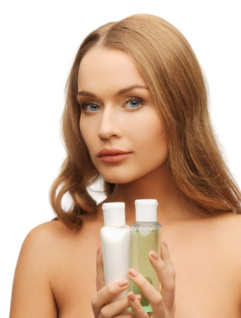 bright picture of woman with cosmetic bottles Stock Photo - 17540238