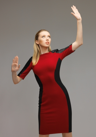 picture of futuristic woman working with something imaginary Stock Photo - 17540198