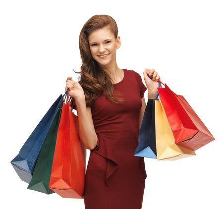 picture of teenage girl in red dress with shopping bags Stock Photo - 17540159