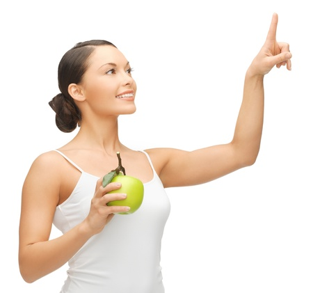 woman holding apple and working with something imaginary photo
