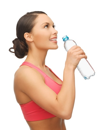 picture of sporty woman with bottle of water photo