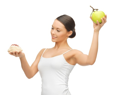 picture of beautiful woman with cake and apple photo
