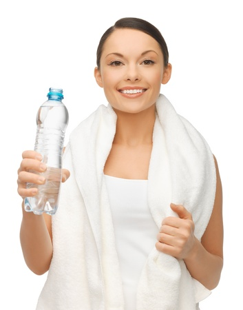 picture of woman with bottle of water and towel photo