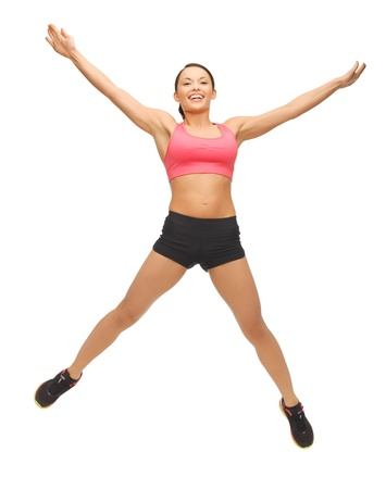 air jump: picture of beautiful sporty woman doing exercise
