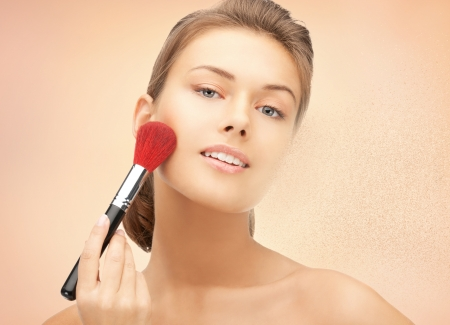 bright closeup portrait picture of beautiful woman with brush Stock Photo - 17540325