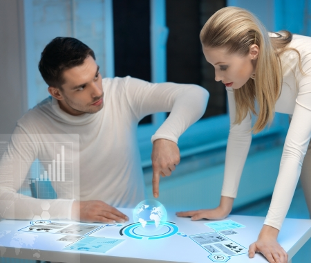 futuristic girl: picture of man and woman working with virtual screens