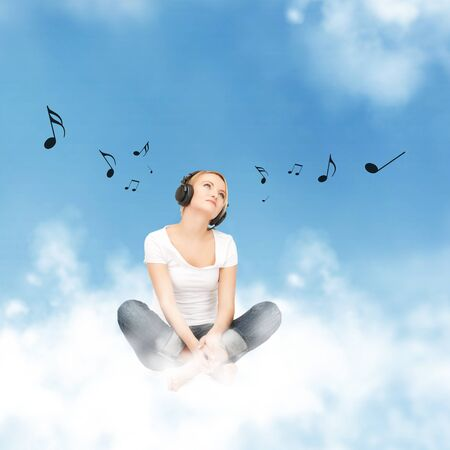 picture of happy teenage girl in big headphones sitting on cloud photo