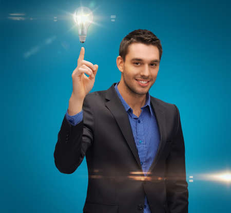 picture of man in suit with light bulb Stock Photo - 17540193