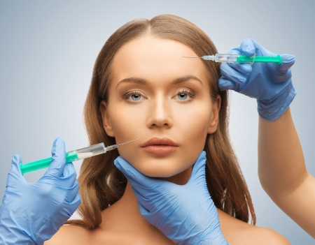 picture of woman face and beautician hands with syringes Stock Photo - 17540235