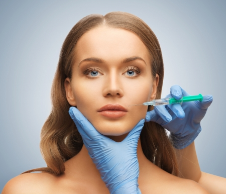 picture of woman face and beautician hands with syringe Stock Photo - 17540155