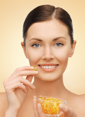 bright picture of beautiful woman with vitamins Stock Photo - 17540190