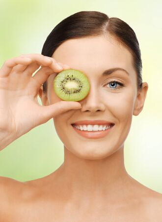 bright picture of beautiful woman with kiwi slice photo